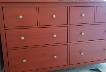 Red orange ikea hemnes 8 draw dresser with gold coloured knobs